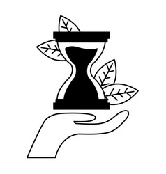 Hand holding hourglasses vector