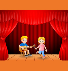 little boy playing guitar and singing girl dancing vector image