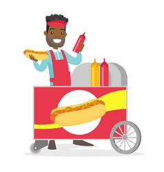 African-american street seller making a hot dog vector
