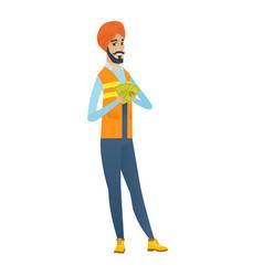 Happy hindu builder holding money vector