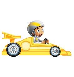 A boy riding in a yellow racing car vector image