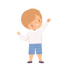 cute little happy boy waving his hand cartoon vector image