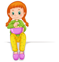 Little girl in pajamas eating popcorn vector
