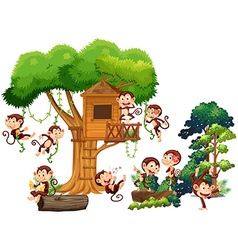 Monkeys playing and climbing up the treehouse vector