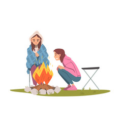 two girls sitting and warming near campfire vector image