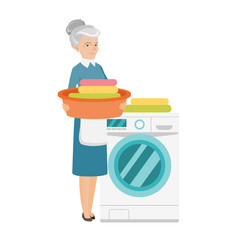 Senior housewife using washing machine at laundry vector