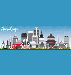 Surabaya skyline with gray buildings and blue sky vector