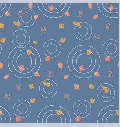 autumn leaves in a blue puddle with circles vector image