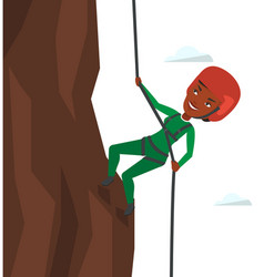 Woman climbing in mountains with rope vector