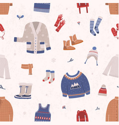 Seamless pattern with winter clothes and outerwear vector