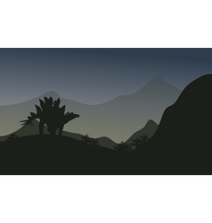 Silhouette of stegosaurus in hills vector
