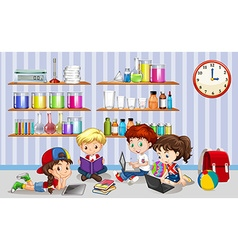 Children working on computers in classroom vector image