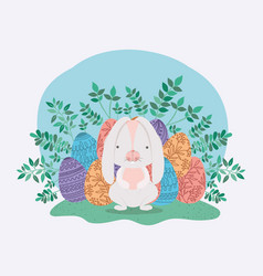 cute rabbit with eggs painted and leafs in the vector image
