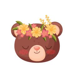Bear head with flower wreath flora and fauna vector