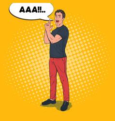 Pop art man showing gun gesture with fingers vector