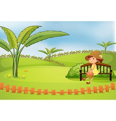 A pretty woman sitting in a bench vector image