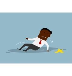 Cartoon businessman slipped on a banana peel vector image