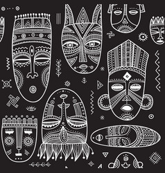 Seamless pattern with african ethnic tribal masks vector