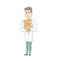 Young caucasian pediatrician holding teddy bear vector