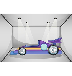 A violet sports car inside the garage vector image