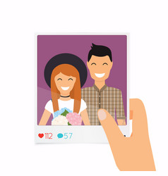 Hand holds a photo with a picture a couple vector
