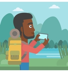 Man with backpack taking photo vector image vector image