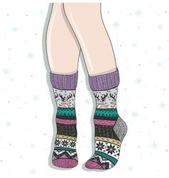 Woman wearing a pair wool socks vector