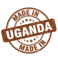Made in uganda brown grunge round stamp vector