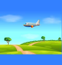 A passenger plane flying over field vector