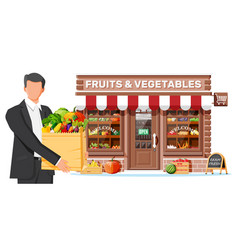 fruit and vegetable store facade with man vector image