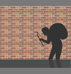 burglar in front of brick wall vector image