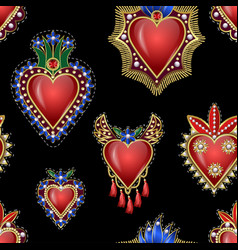 Seamless pattern with traditional mexican hearts vector
