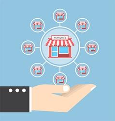 Businessman hand holding franchise marketing vector image vector image