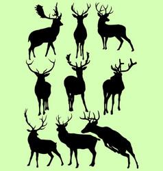 black deer silhouettes vector image