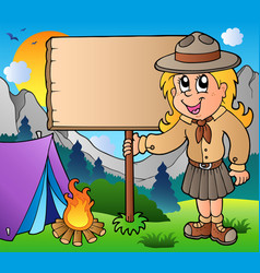 Scout girl holding board outdoor vector