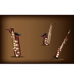 Three Retro Saxophone on Dark Brown Background vector image vector image