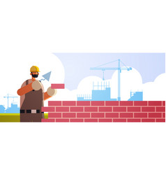 Male builder using spatula workman laying brick vector