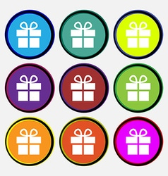 Gift box icon sign Nine multi-colored round vector