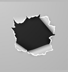 torn hole in sheet paper with black background vector image