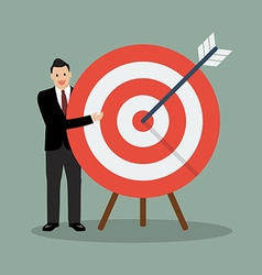 Businessman pointing to big target vector