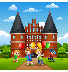 happy kids playing in front of holstentor vector image