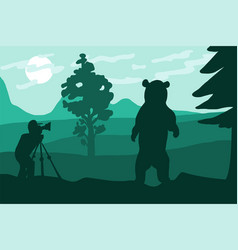 photographer photographs bear in nature vector image
