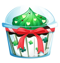 A disposable cupcake container with red ribbon vector
