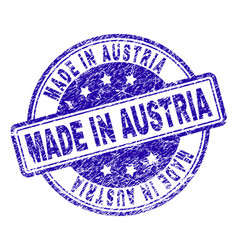 Scratched textured made in austria stamp seal vector