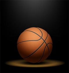 Basketball under spotlight vector image