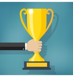 Hand holding a winner trophy cup vector image