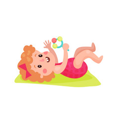 adorable little girl lying on her back playing vector image
