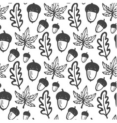 Seamless pattern with acorns and maple oak leaves vector