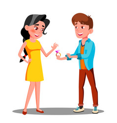 young man gives an engagement ring to happy girl vector image