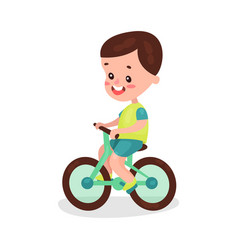 adorable brunette little boy riding bike cartoon vector image